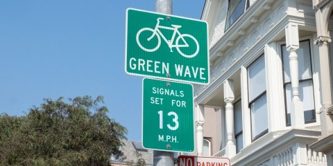 A green wave sign on Folsom Street
