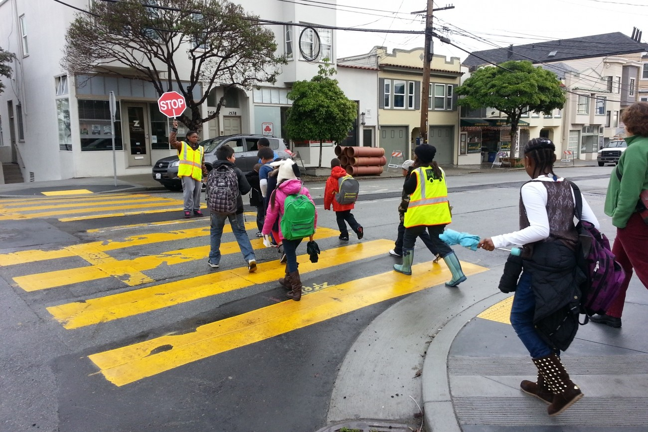 Kids crossing the street with a crossing guard at 20th and Connecticut streets