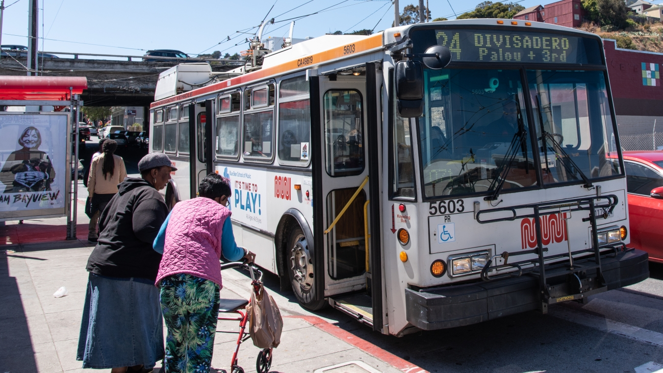 People boarding a 24 bus in the Bayview