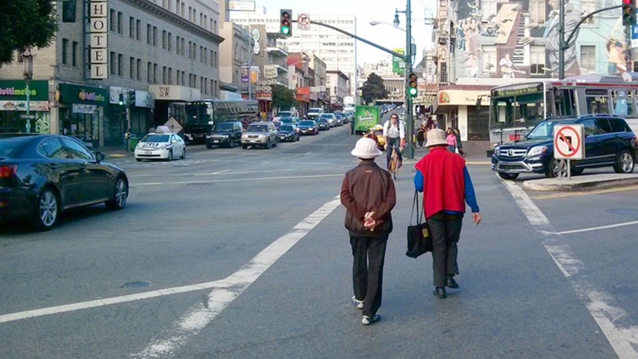 People in a Chinatown crosswalk
