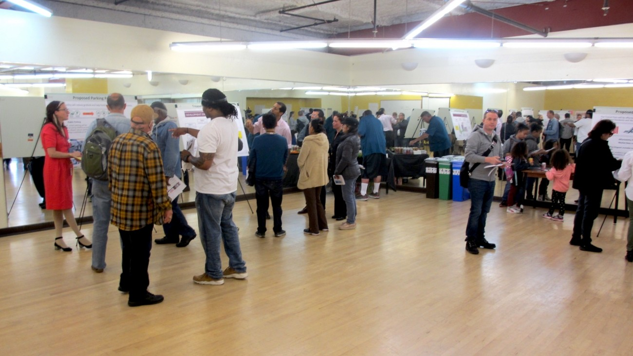 Project staff taking feedback from residents at an open house