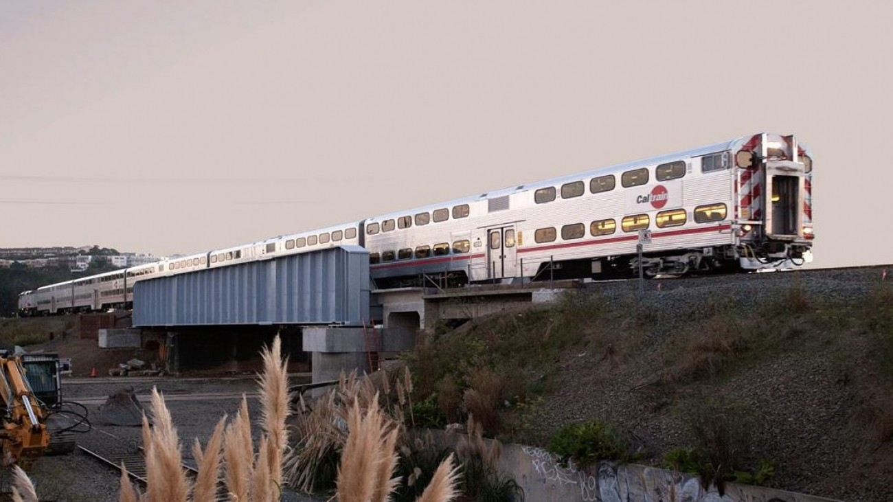 A view of a Caltrain vehicle crossing Jerrold Avenue