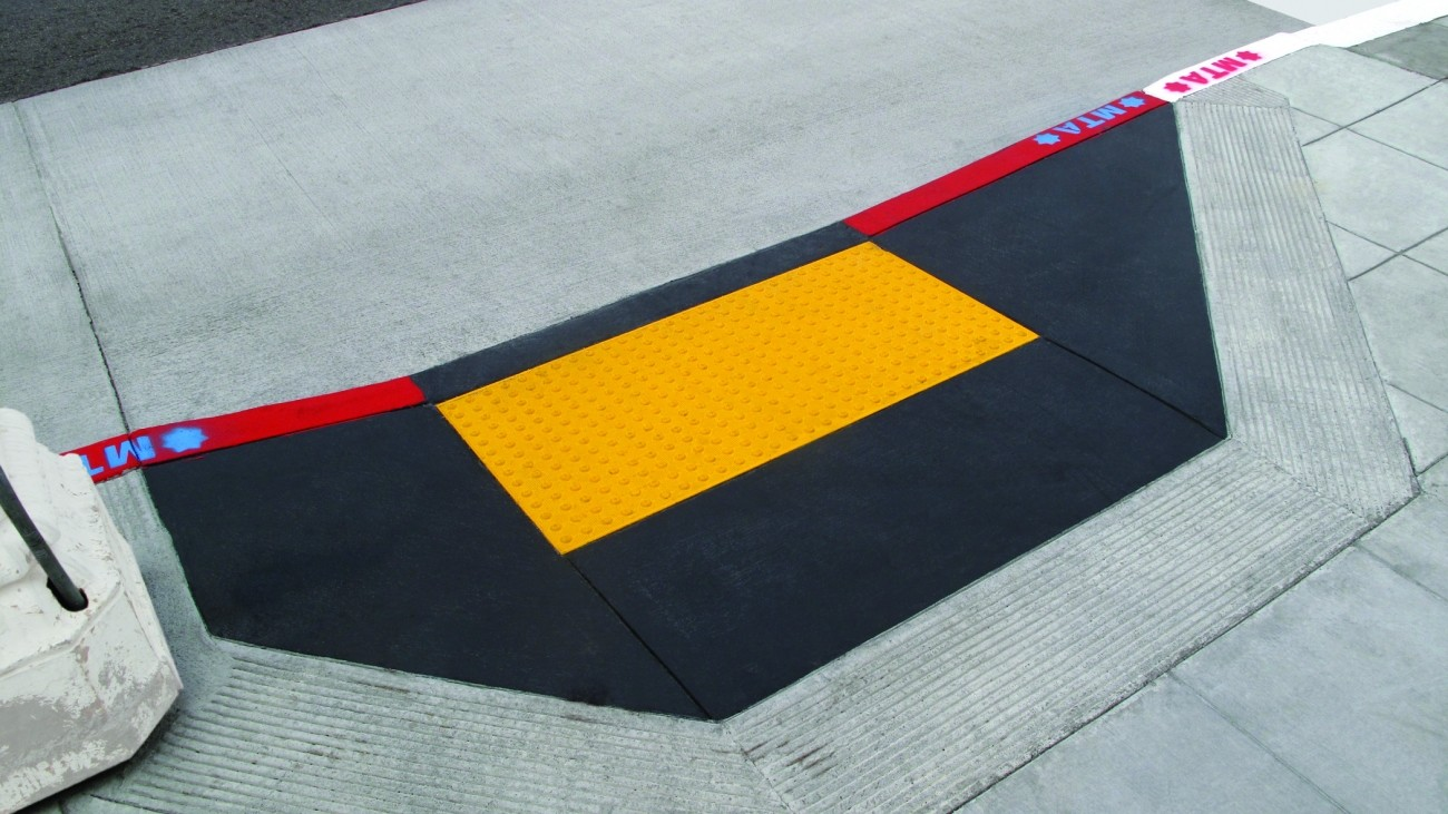 A bright yellow curb ramp