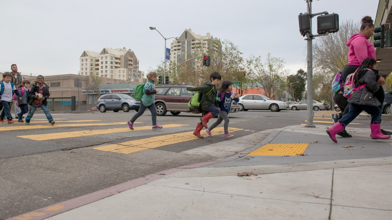 kids crossing a street