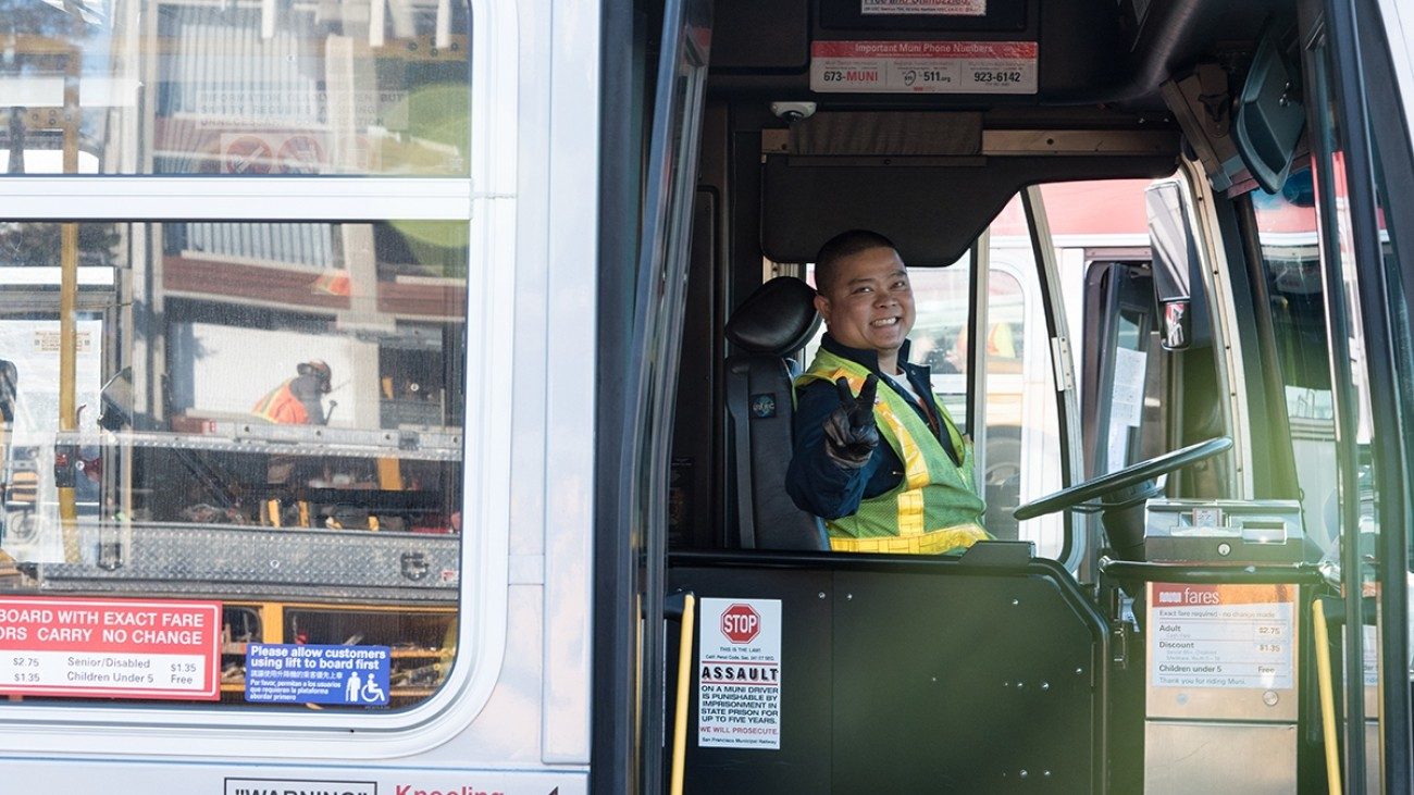 SFMTA Muni bus driver holding up peace sign