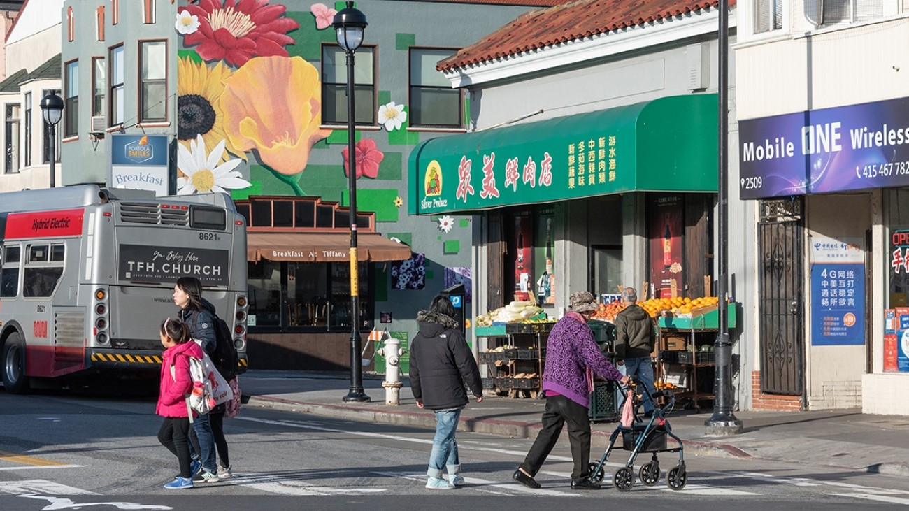 People crossing the street on San Bruno Ave in San Francisco