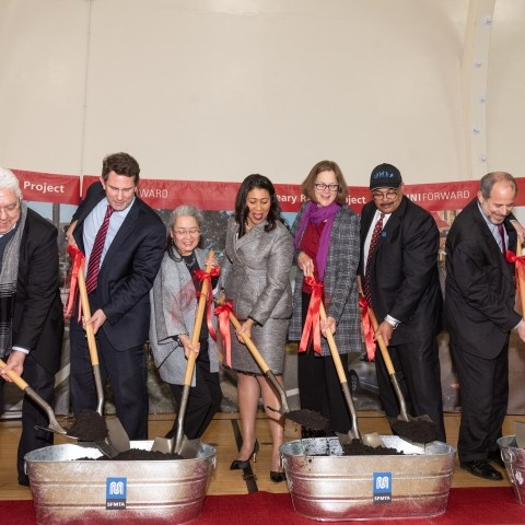 Elected officials digging shovels into dirt at the Geary groundbreaking