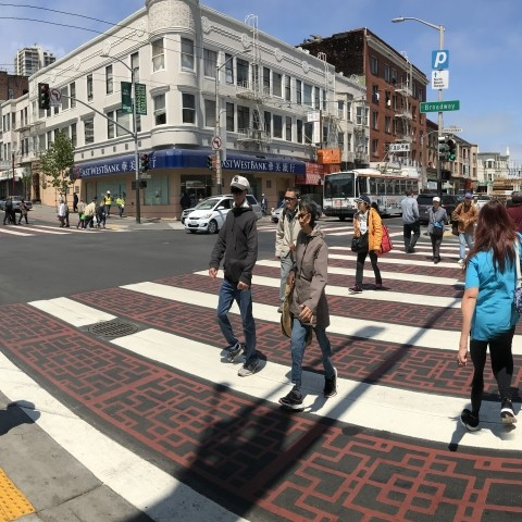 People crossing the street in a new crosswalk in Chinatown