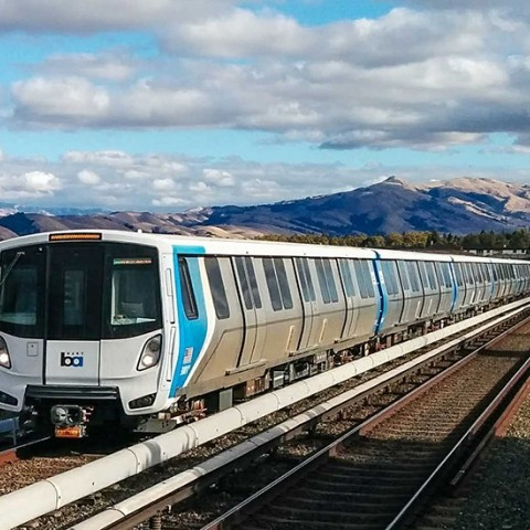 New bart train pulling in to a station