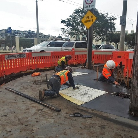 construction workers building a curb ramp