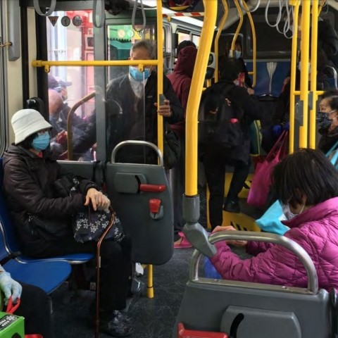 People riding a bus during shelter-in-place